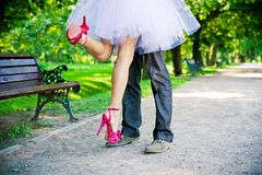 Legs of the groom and the bride. Stock Images