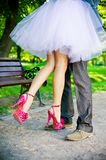 Legs of the groom and the bride. Royalty Free Stock Photography