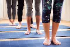 Midsection of group of senior people doing exercise in community center club. stock photo