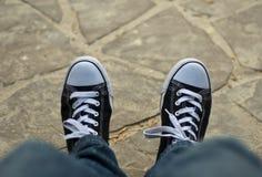 Legs in gumshoes. Men or women legs in gumshoes Stock Photo