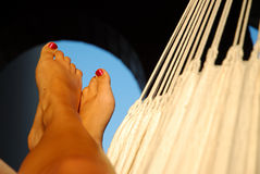 Legs in hammock Royalty Free Stock Photography