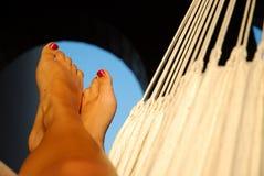 Legs in hammock Royalty Free Stock Photography