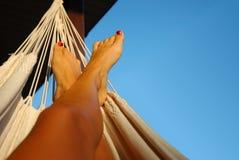 Legs in hammock Royalty Free Stock Image