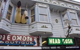 Legs hanging out of window on haight street Stock Image