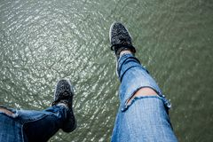 Legs over water royalty free stock photography