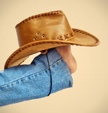 Legs with hat on brown Stock Photography