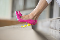 Legs and high heel stilettos sitting relaxed Royalty Free Stock Photo