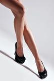 Legs in high heels. Beautiful woman legs in high heels shoes, studio shot stock image