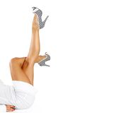 Legs and high heels. On a white background Royalty Free Stock Images