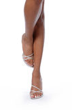 Legs with High Heels. Woman's legs with silver high heels Stock Images