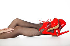 Legs with high heels and hands Royalty Free Stock Image