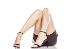 Legs in high heels. Pretty female legs in elegant black sandals with high heels royalty free stock photo