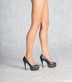 Legs on high heels standing studio Royalty Free Stock Photos