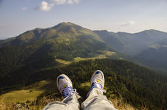 Legs hiker. On top mountains Stock Photos