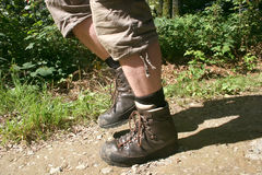 Legs with hiking boots royalty free stock image