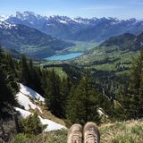 Legs in hiking shoes with view to mountain landscape Stock Photo