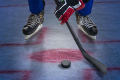 Legs of hockey player. Royalty Free Stock Image