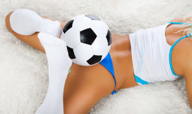 Legs holding ball Royalty Free Stock Images