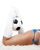 Legs holding a ball Stock Photo