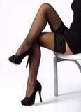 Legs In Black Stockings Royalty Free Stock Image