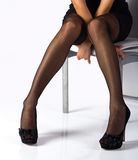 Legs In Black Stockings Royalty Free Stock Photos