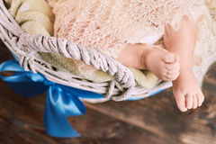 Legs of infant in basket. Stock Images