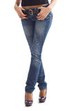 Legs in jeans Stock Images