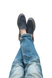 Legs in jeans and boots isolated on white background. Stock Photo