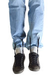 Legs in jeans and dirty sneakers Stock Image