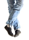 Legs in jeans and dirty sneakers Stock Photos