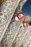legs in jeans and red sneakers on an antique metal staircase. To stock photography