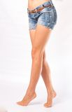 Legs and jeans shorts Royalty Free Stock Photos