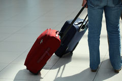 Legs in jeans with suitcase Royalty Free Stock Photo