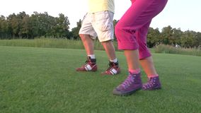 Legs of jogging couple. People are running on grass. Test your endurance. Former olympic medallists stock video