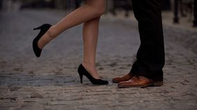 Legs of joyful girl kissing her boyfriend, partners from dating website, romance. Stock footage Stock Photography
