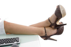 Legs and keyboard Royalty Free Stock Photo