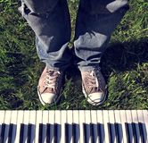 Legs and Keyboard outdoor Royalty Free Stock Photography