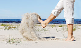 Legs kick sand. Royalty Free Stock Image