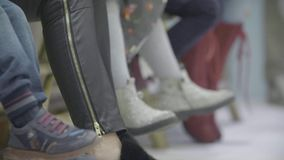 Legs of the kids. Kids shoes in slow motion stock video