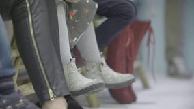 Legs of the Kids. Kids shoes in slow motion stock video footage