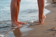 Legs of kissing couple Royalty Free Stock Images