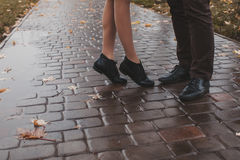 Legs of the kissing couple Stock Photography