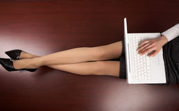 Legs and laptop Stock Photography
