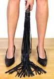 Legs and leather whip Royalty Free Stock Image
