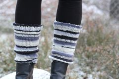 Legs with leg warmers. Legs with striped leg warmers stock photos