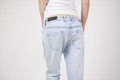 Legs in light blue summer jeans Royalty Free Stock Image