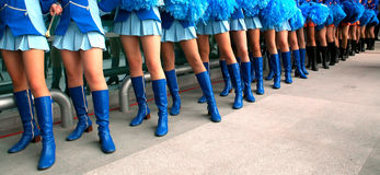 Legs in the line. Young girls standing in the line Stock Photography