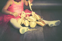 Legs a little ballerina with ballet pointe shoes and pink skirt royalty free stock photography