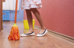 Legs of Little caucasian Female making Cleaning Stock Images