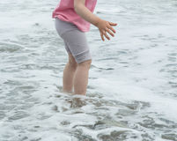 Legs of a little girl in the sea water Stock Photo